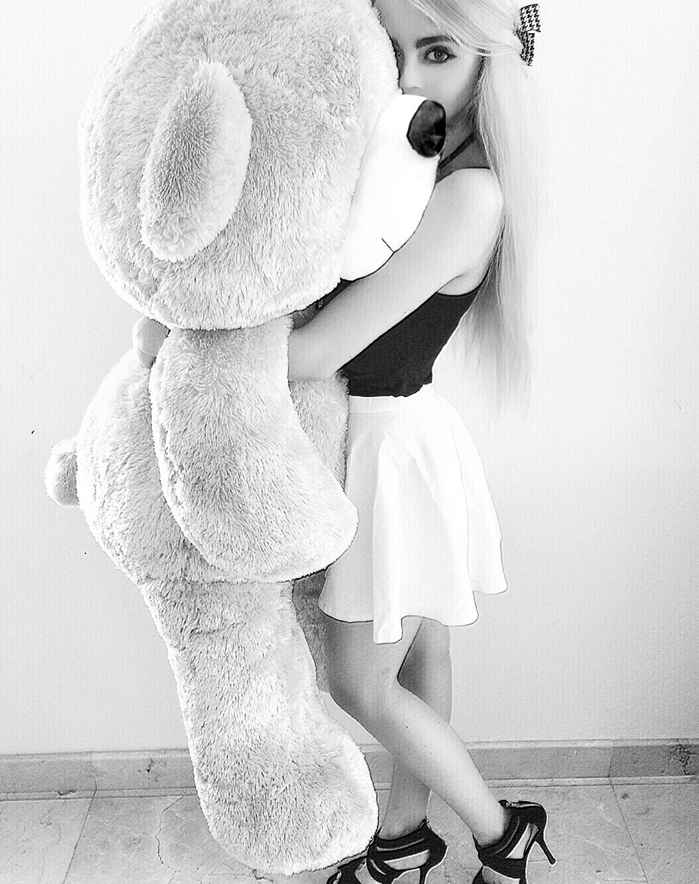 aesthetic, b&w, black and white, blonde, book, bow, fun, gift, hair, high heels, hugging, laugh, long blonde hair, love, makeup, now, present, quote, ribbon, skirt, teddy bear, white skirt, black crop top, cute gift, First Set on Favim.com