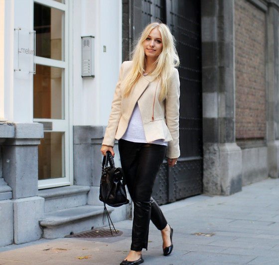 beige, black shoes, blonde and curly hair