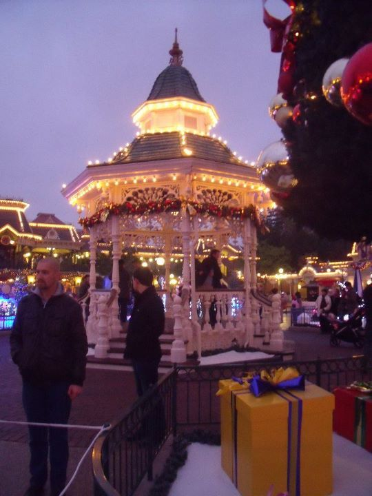 christmas, christmas lights, christmas tree, cold, disney, disneyland, disneyland paris, fairy lights, france, gazebo, green, lights, paris, people, pink, presents, tree, winter