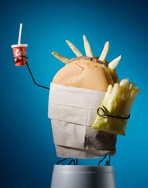 coke, fake liberty statue, fries, hamburger