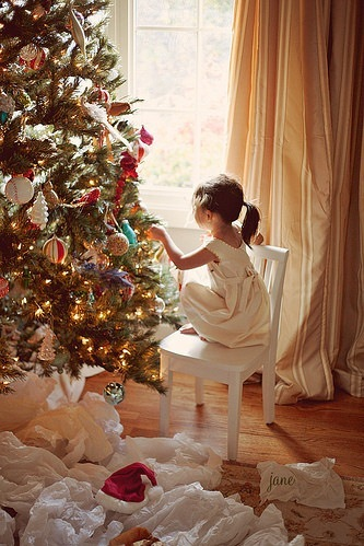 adorable, chair, christmas, christmas tree, cute, decor, decorate, decorating, girl, jolly, joy, lights, little, little girl, living room, pony tail, presents, rejoice, tiny