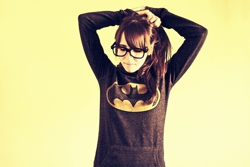 adorable, bat, batman, cute, girl, glasses, hair, hero, hip, hipster, hoodie, hot, nerd, pony, ponytail, red head, scene, scenester, shirt, sweater, sweatshirt, symbol, wall, yellow