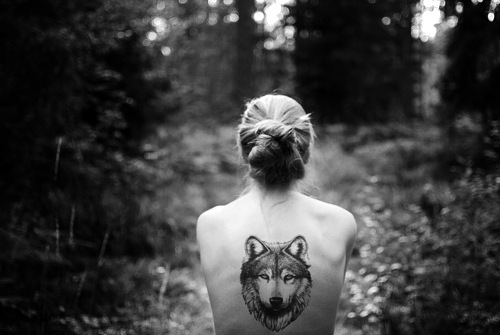 back, black and white, blond, forest, girl, misterious, sad, tattoo, wolf, wolf tattoo