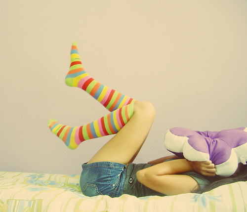 adorable, bed, bedroom, betweeneachsmile, blue, colorful, colorful stripes, cute, girl, green, happiness, jeans, legs, orange, pink, red, shorts, socks, stripes, stuffed, yellow